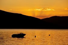 Free Boat At Sunset Royalty Free Stock Photography - 18250797