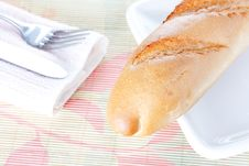 Free Baguette On White Plate, Napkin, Fork And Knife Royalty Free Stock Photos - 18250958