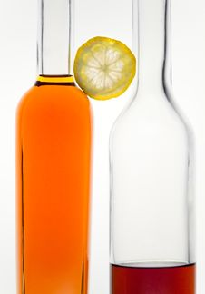 Free Two Bottles And Lemon Royalty Free Stock Images - 18251839
