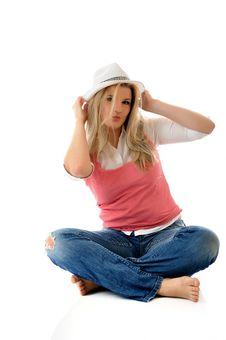 Young Casual Smiling Woman In White Hat Royalty Free Stock Images