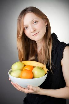Free Pretty Blond Holding Healthy Fruit Royalty Free Stock Photography - 18254867