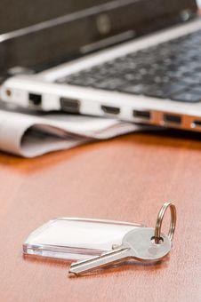 Free Key With A Trinket Royalty Free Stock Photo - 18256125