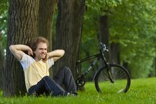 Free Young Man Siting Under The Tree Near His Bycicle Stock Photos - 18258293