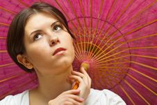 Free Young Woman Under Wooden Orient Umbrella Royalty Free Stock Photo - 18258405