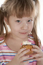 Free Small Girl Is Eating Cake Stock Photos - 18264733