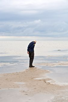 Free Man Walking In Tidal Flat Royalty Free Stock Photos - 18262348