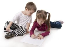 Free Brother And Sister Draws On A Ruler Royalty Free Stock Images - 18264709