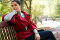 Free Woman Sitting In A Park On A Wooden Bench, Royalty Free Stock Image - 18276276