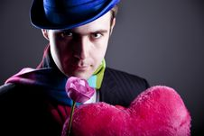 Free Mysterious Men With Toy And Rose Stock Photo - 18271470