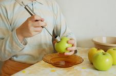 Taking Out An Apple Core. Focus On A Corer. Royalty Free Stock Images