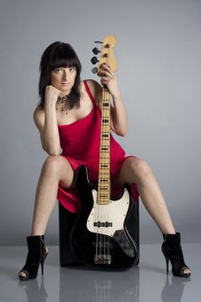 Woman In Red Dress With Guitar Royalty Free Stock Photography