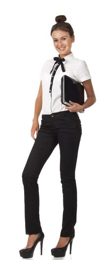 Free Girl In Office Attire Stands And Holds A Laptop Co Royalty Free Stock Image - 18275096