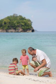 Father And Two Children On Beach Royalty Free Stock Photos