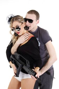 Girl Holding A Weapon With A Men Be Stock Photography