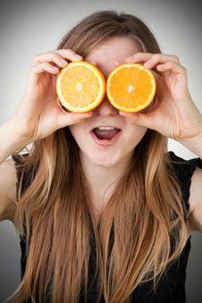 Free Girl Using Orange As Eyes, With Grey Background Royalty Free Stock Image - 18275266