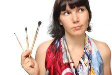 Free Beautiful Girl Holding Brushes. Royalty Free Stock Photos - 18276108