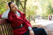 Free Woman Sitting In A Park On A Wooden Bench, Royalty Free Stock Photo - 18276275
