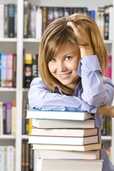 Free Young Woman Sitting  In  Library Stock Image - 18278981