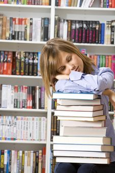Young Woman Sleeping With Books