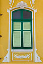 Free Closed Green Window On The Yellow Wall Royalty Free Stock Photo - 18281145