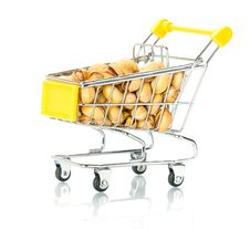 Pistachios In The Shopping Cart Royalty Free Stock Photo