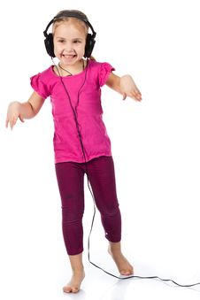 Free Beautiful Girl In Headphones Dancing To The Music Royalty Free Stock Image - 18283206