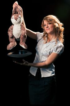 Free Girl With A Toy Rabbit Got Out Of The Hat Royalty Free Stock Photos - 18283988