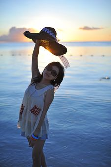 Free Girl In Sunset With A Straw Hat Stock Image - 18284411