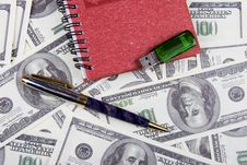 Dollars, Notebook And Pen Stock Photography