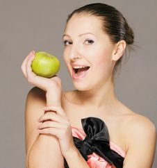 Free Young Girl With Apple Royalty Free Stock Image - 18284866