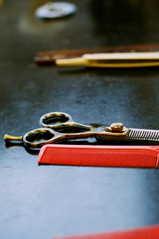 Barbers  Scissors With Red Comb Royalty Free Stock Images