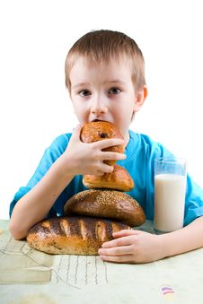 Free Happy Boy Eating Bread Royalty Free Stock Photo - 18285595