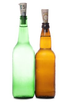 Free Beer And Cider Bottles With Sterling Money Stock Images - 18285914