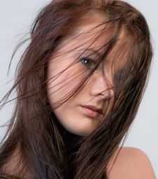 Attractive Young Woman With Blowing Hair Stock Photo