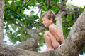 Free Cute Boy On A Tree Royalty Free Stock Photos - 18296688