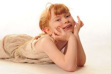 Free Cute Little Girl Lying On Floor Royalty Free Stock Photography - 18290537