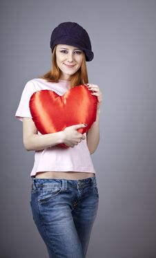 Beautiful Red-haired Girl In Cap With Toy Heart. Stock Photos