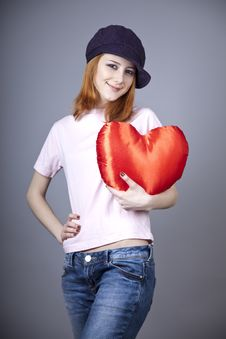 Beautiful Red-haired Girl In Cap With Toy Heart. Stock Image