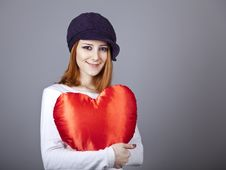 Beautiful Red-haired Girl In Cap With Toy Heart. Royalty Free Stock Images