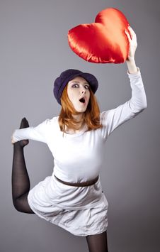 Beautiful Red-haired Girl In Cap With Toy Heart. Stock Photo
