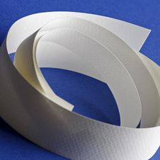Round White Textured Paper Strips On Blue Stock Photography