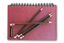 Free Notebook On The White With Pencils. Royalty Free Stock Photo - 18298865