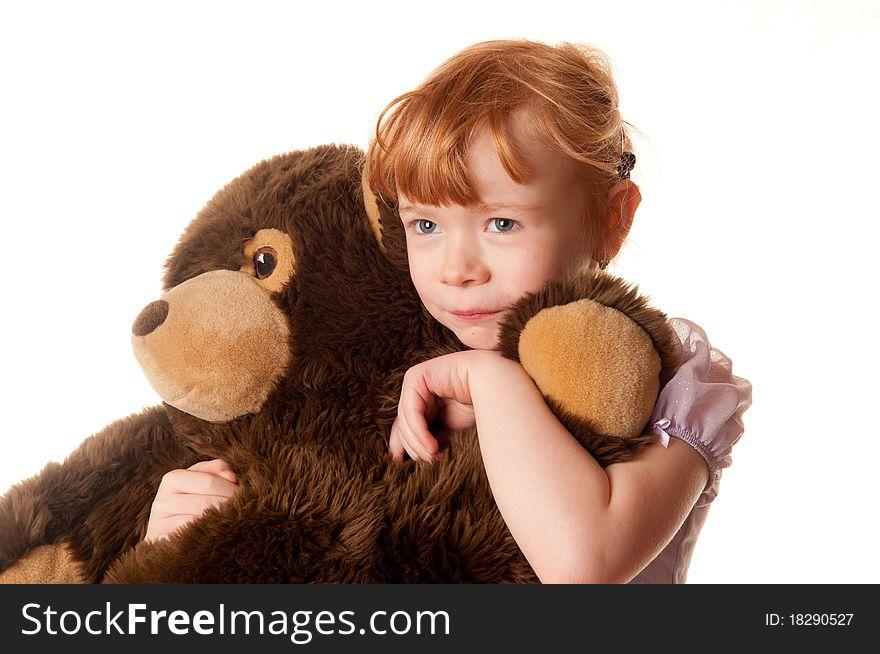Cute little girl holding a teddy bear