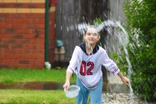 Water Play In Rain Royalty Free Stock Images