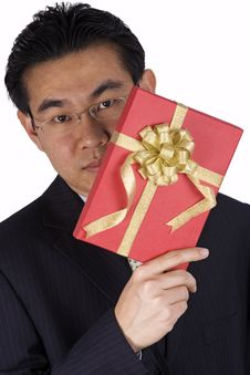 Free Chinese Businessman Holding Present Royalty Free Stock Photography - 1836747