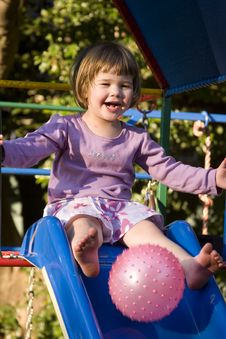 Free Girl Playing On Slide Royalty Free Stock Photography - 1837967