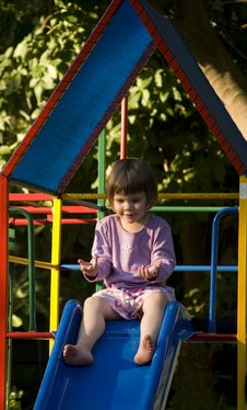 Free Girl Playing On Slide Stock Image - 1838121