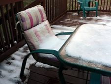 Snow On Patio Chair Royalty Free Stock Photo