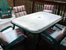 Snow On Patio Furniture Royalty Free Stock Images