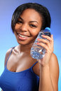 Free Beautiful Healthy Black Girl With Bottled Water Royalty Free Stock Photography - 18308617